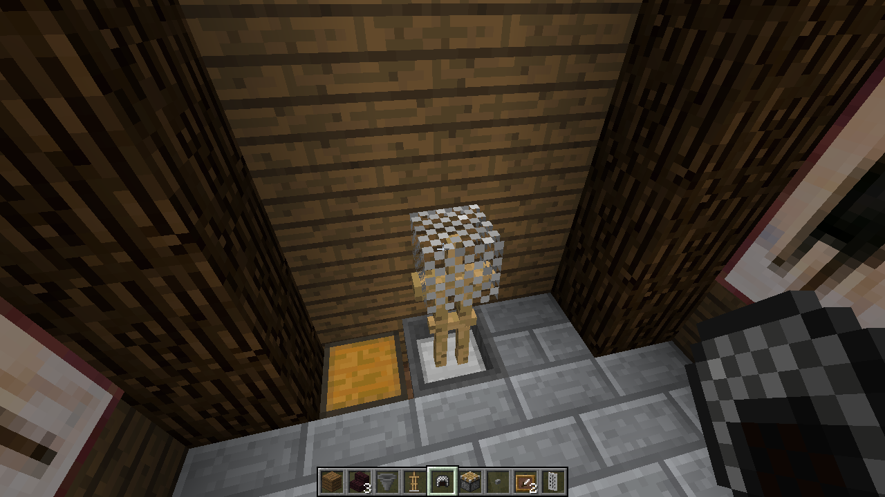 Place an armour stand in the hopper and add a chain helmet.